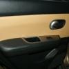 Бежевые авточехлы уровня перетяжки салона Nissan Tiida №8