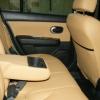 Бежевые авточехлы уровня перетяжки салона Nissan Tiida №9