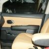 Бежевые авточехлы уровня перетяжки салона Nissan Tiida №11