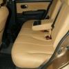 Бежевые авточехлы уровня перетяжки салона Nissan Tiida №14