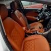 Чехлы для Opel Astra J из коричневой  экокожи с ромбом №1