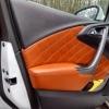 Чехлы для Opel Astra J из коричневой  экокожи с ромбом №15