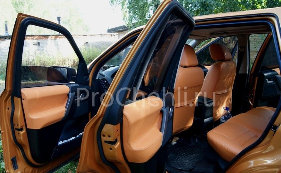 Авточехлы из оранжевой экокожи Land Rоver Freelander 2