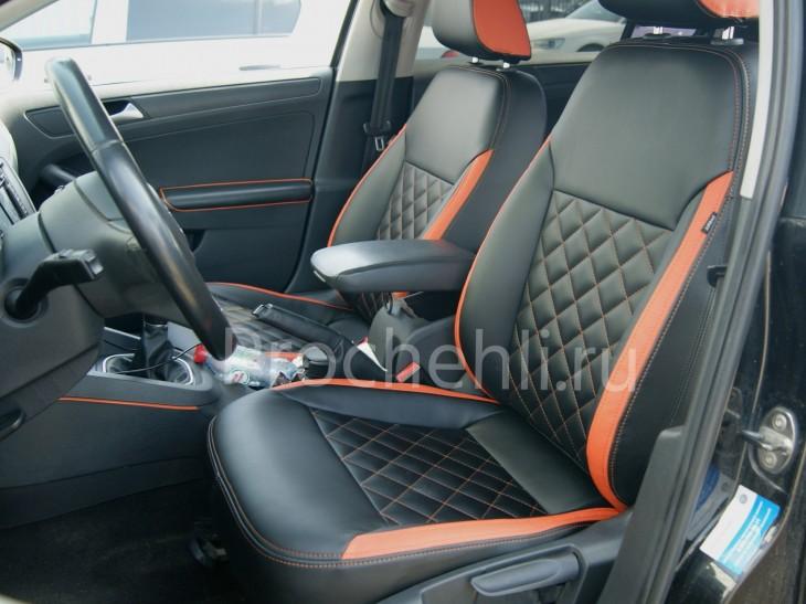 Каркасные чехлы с эффектом перетяжки на Volkswagen Jetta Trendline из черной и оранжевой экокожи №1