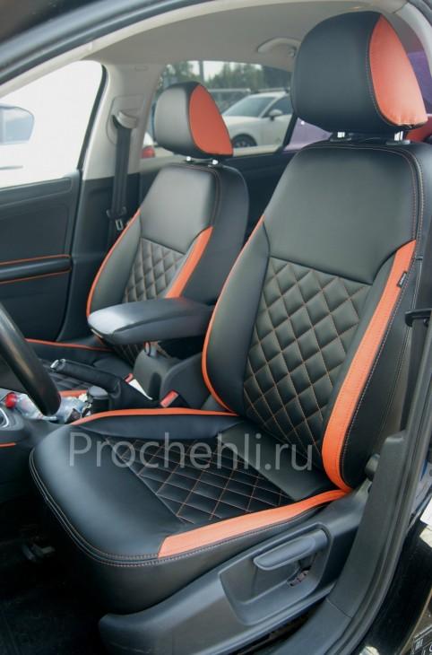 Каркасные чехлы с эффектом перетяжки на Volkswagen Jetta Trendline из черной и оранжевой экокожи №4