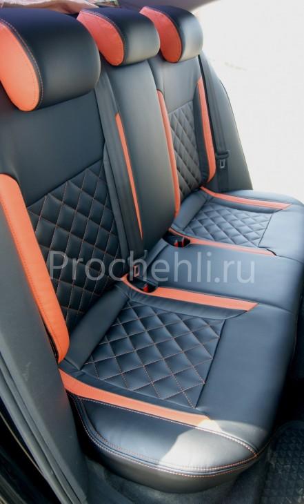 Каркасные чехлы с эффектом перетяжки на Volkswagen Jetta Trendline из черной и оранжевой экокожи №7