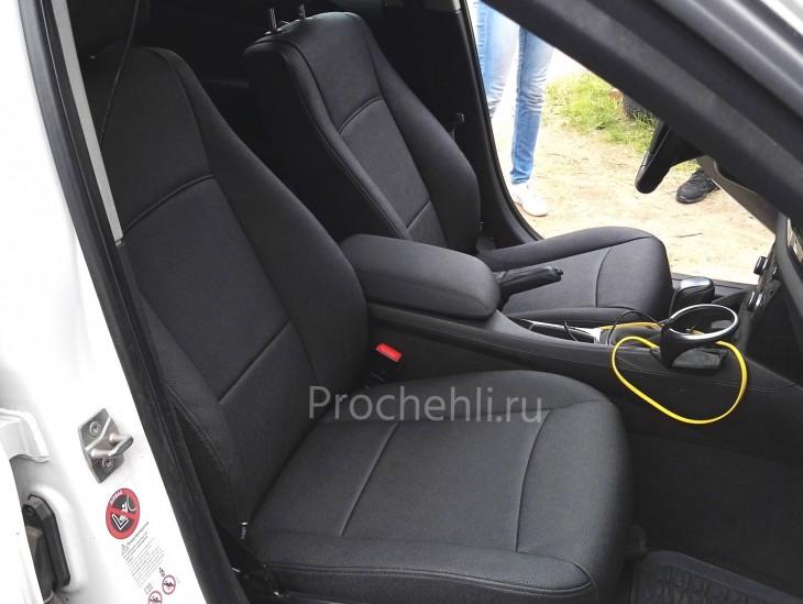 Каркасные авточехлы с эффектом перетяжки салона для BMW X1 (E84) из черной экокожи №1