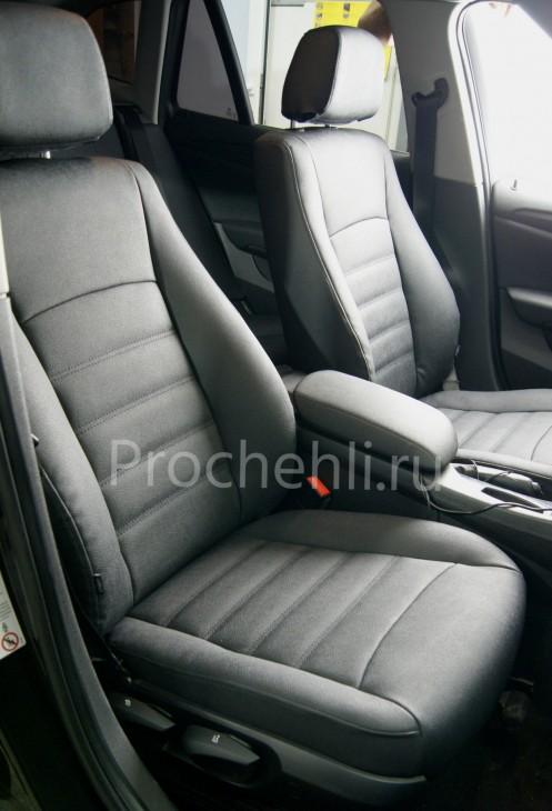 Каркасные авточехлы с эффектом перетяжки салона для BMW X1 (E84) из черной экокожи №4