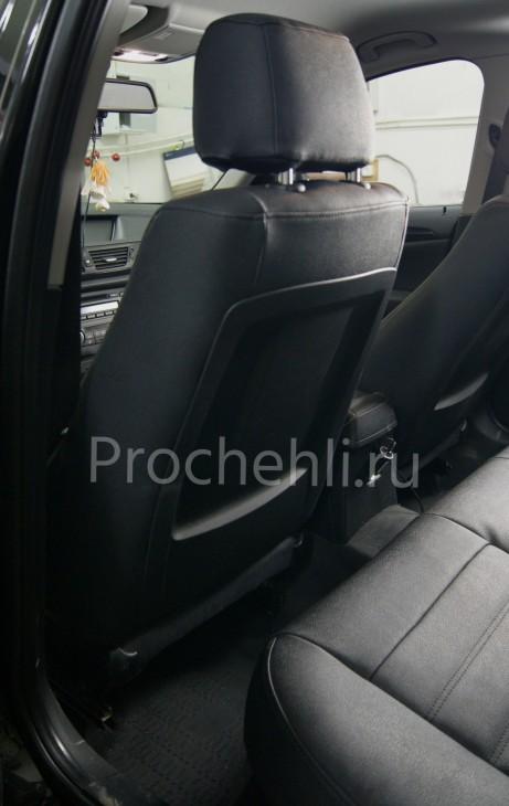 Каркасные авточехлы с эффектом перетяжки салона для BMW X1 (E84) из черной экокожи №5