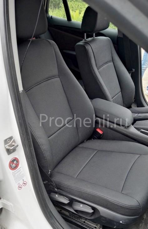 Каркасные авточехлы с эффектом перетяжки салона для BMW X1 (E84) из черной экокожи №3