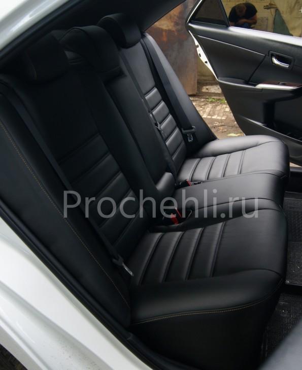 Чехлы на Toyota Camry 7 с эффектом перетяжки салона из черной экокожи с двойной строчкой №5