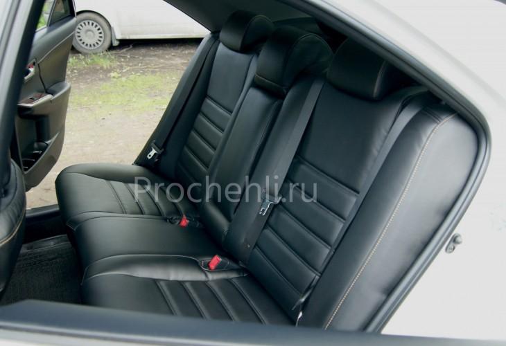 Чехлы на Toyota Camry 7 с эффектом перетяжки салона из черной экокожи с двойной строчкой №7