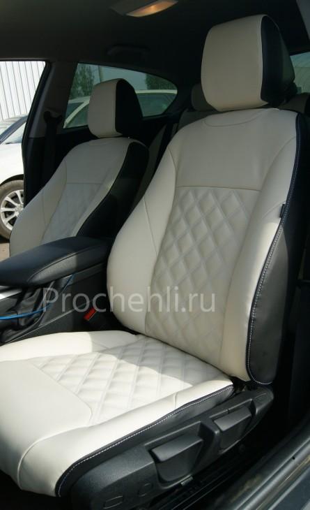 Чехлы на BMW 1-er F21 с эффектом перетяжки из черной и белой экокожи №3