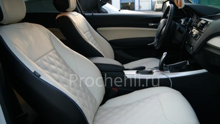 Чехлы на BMW 1-er F21 с эффектом перетяжки из черной и белой экокожи №4